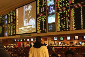 what do the + and - signs mean in sports betting?